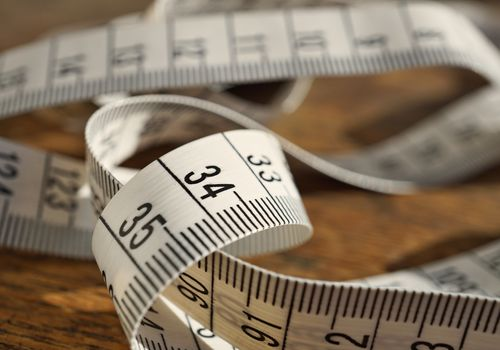 White tape measure (tape measuring length in meters and centimeters)