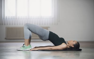 Woman performing a basic bride stretch for tight hips