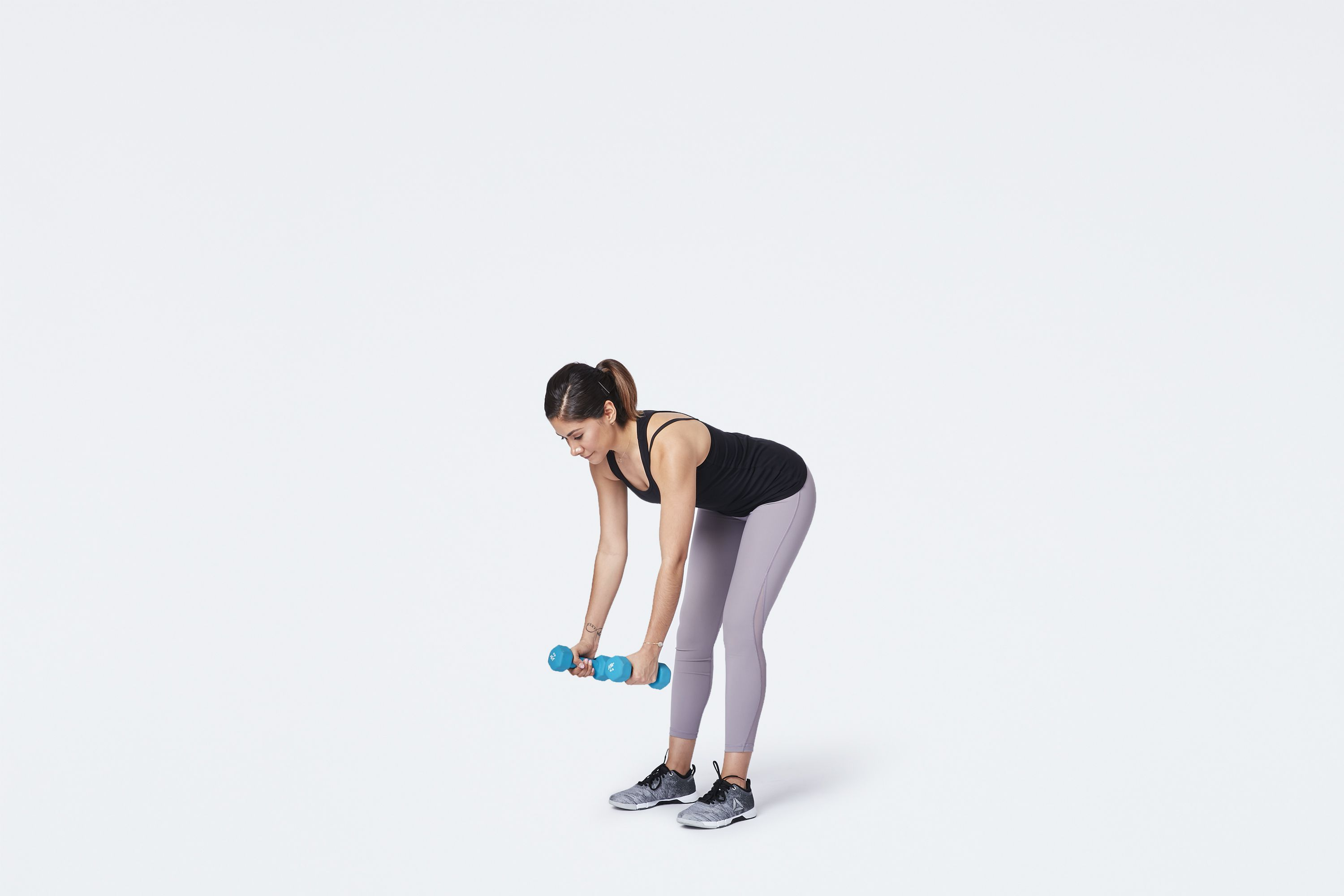 woman starting dumbbell bent over row