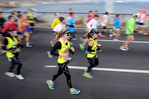 Runners cross the Verrazano-Narrows Bridge at the start of the ING New York City Marathon on November 3, 2013 in the Brooklyn borough of New York City.