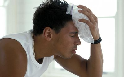 Man with ice pack on head