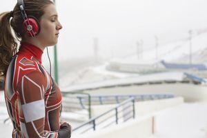Female luge athlete preparing for race