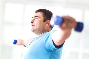 man exercising with dumbbells.