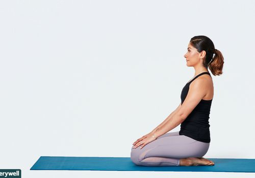Woman doing kneeling shin stretch