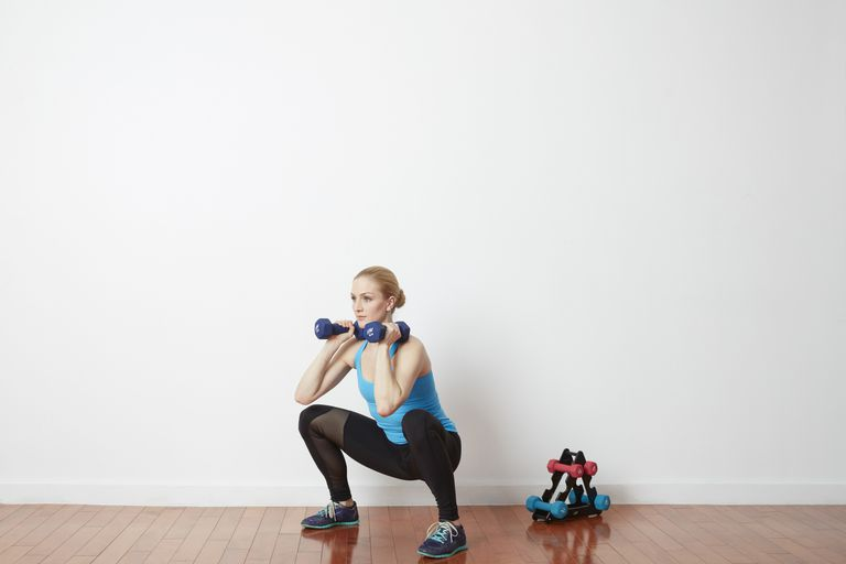 Woman doing squat with weights