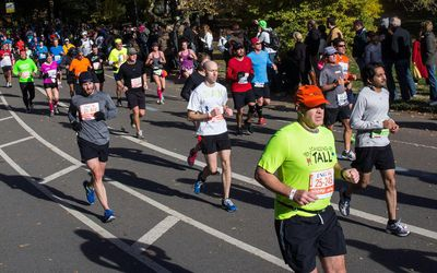 Runners run through Central Park while participating in the ING New York City Marathon on November 3, 2013 in New York City.