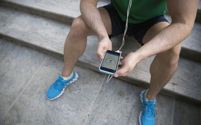 Man checking heart rate on phone