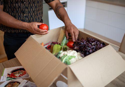 Man unpacking vegetable box