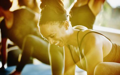 Woman smiling at the gym