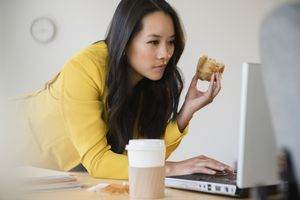 woman-holding-muffin-at-work