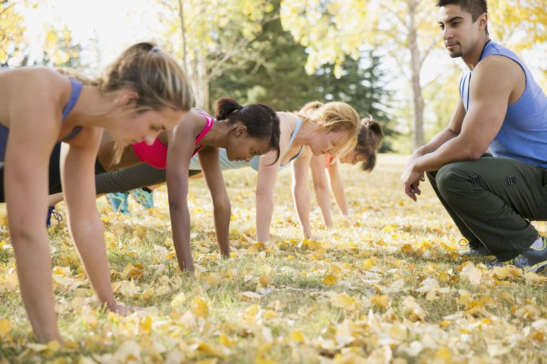 Women training outside with coach