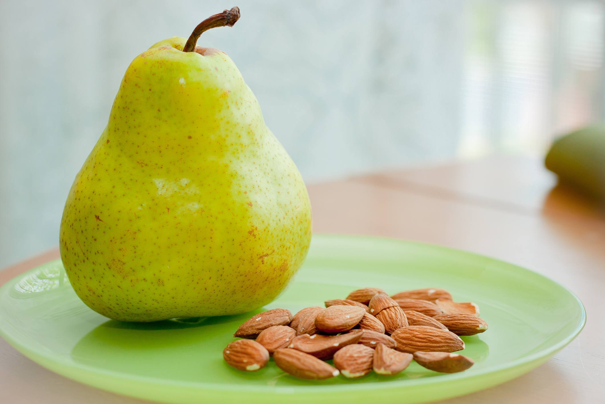 A pear and almonds are great for a work day snack.