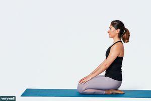Woman doing kneeling shin stretch