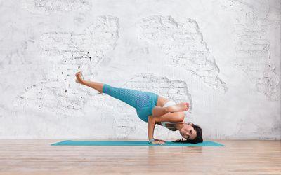 woman performing Sage Kaundinya's Pose (Eka Pada Koundinyasana I) in Yoga