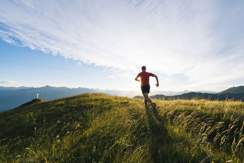 man running on a hillside