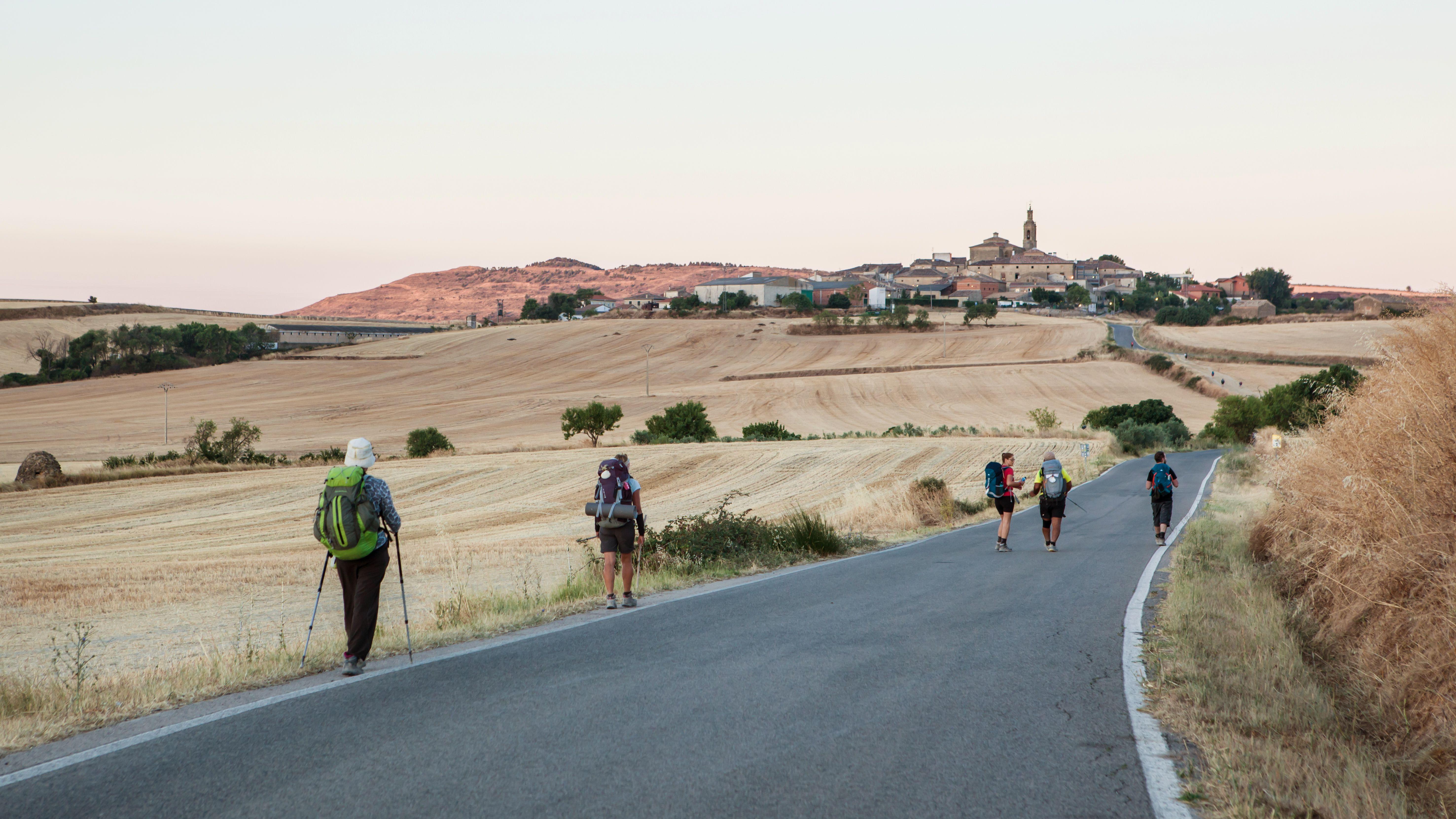 People walking the Way of St. James, Camino de Santiago, Spain Hikers walking the ,Camino de Santiago Walk, Spain