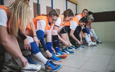 Cheerful girls in the locker room