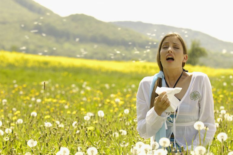woman with allergies in field