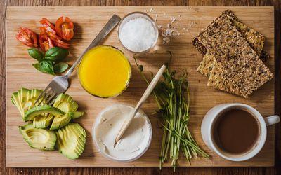 Healthy vegan breakfast with Seed Crisp bread avocado coffee and juice