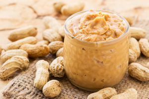 High Angle View Of Peanut Butter In Jar On Table
