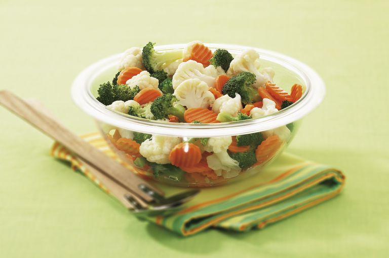 Cooked broccoli, carrots, and cauliflower in a bowl