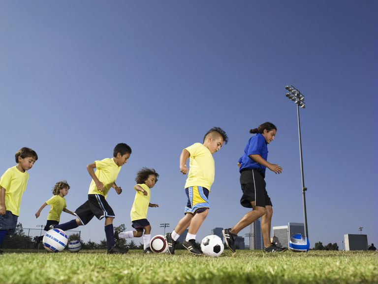 A picture of kids playing soccer