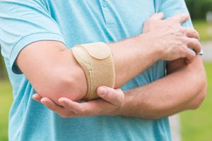 Man holding his elbow