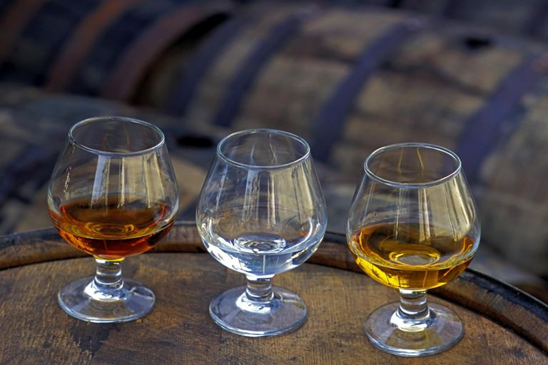Three glasses of rum on barrel