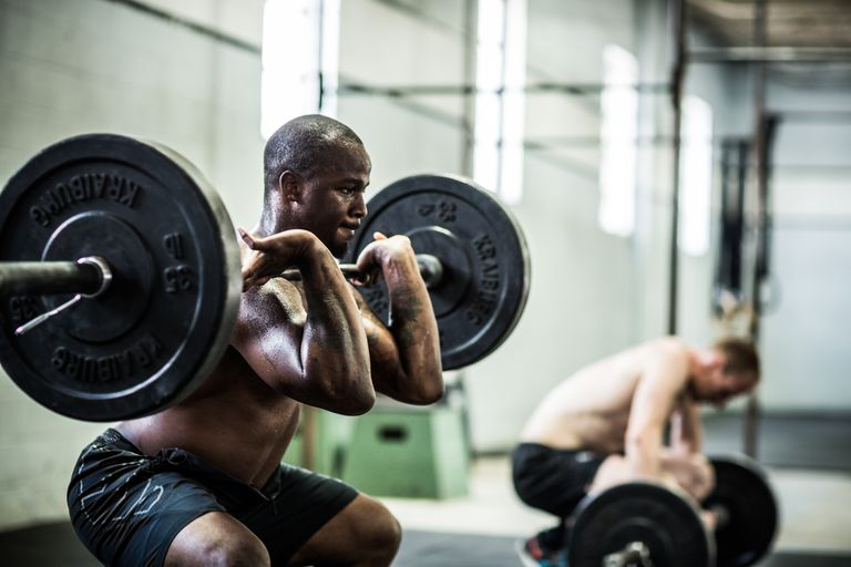 Man squatting with a barbell