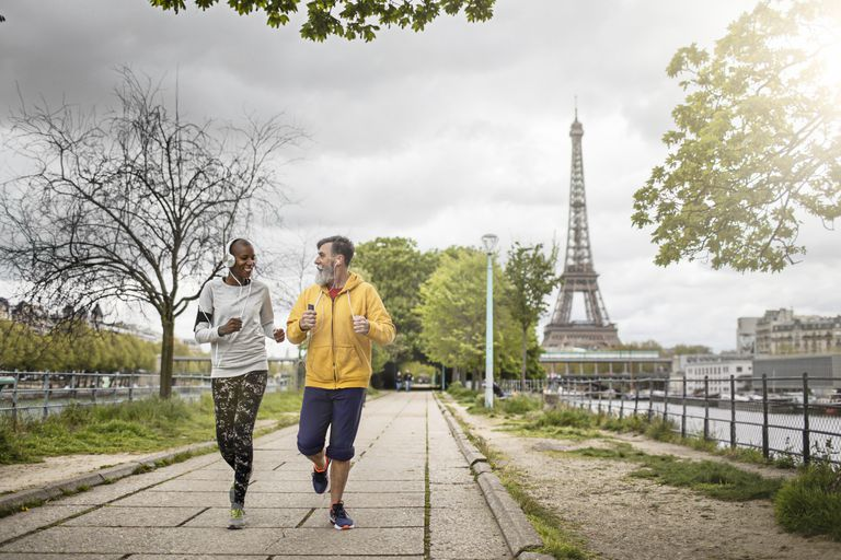 Man and woman jogging in Paris