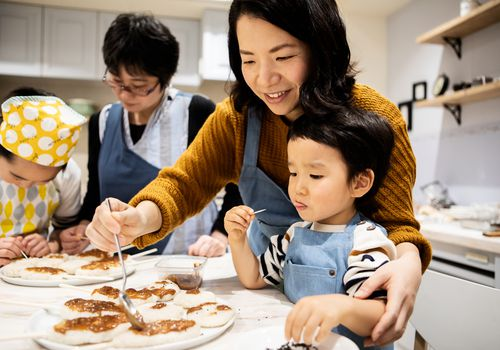 Parents cooking with kids