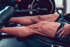 Bodybuilder Working Leg Muscles In Gym