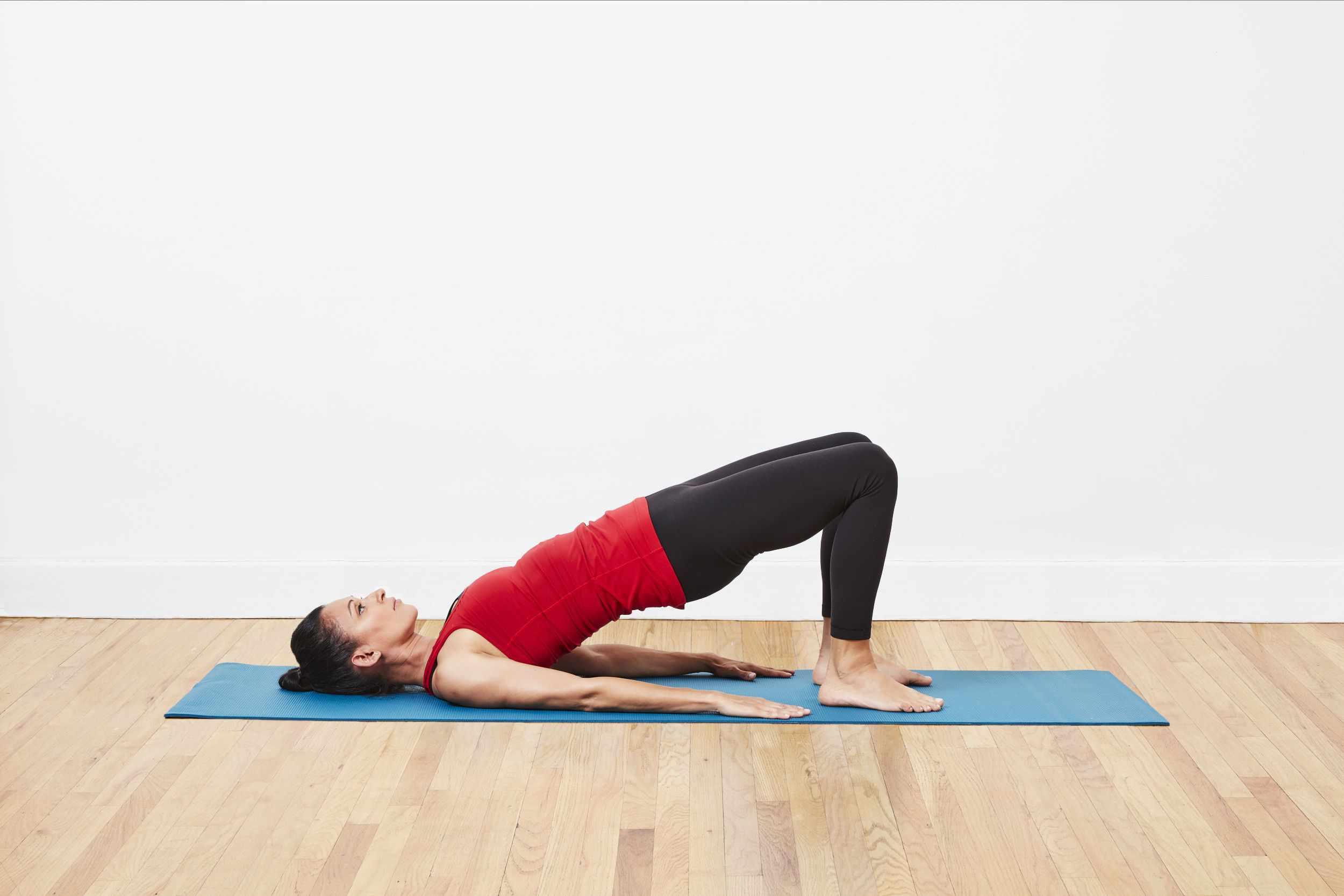 Woman performing basic bridge stretch