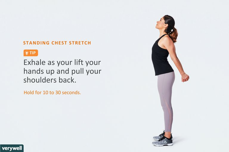 woman doing standing chest stretch