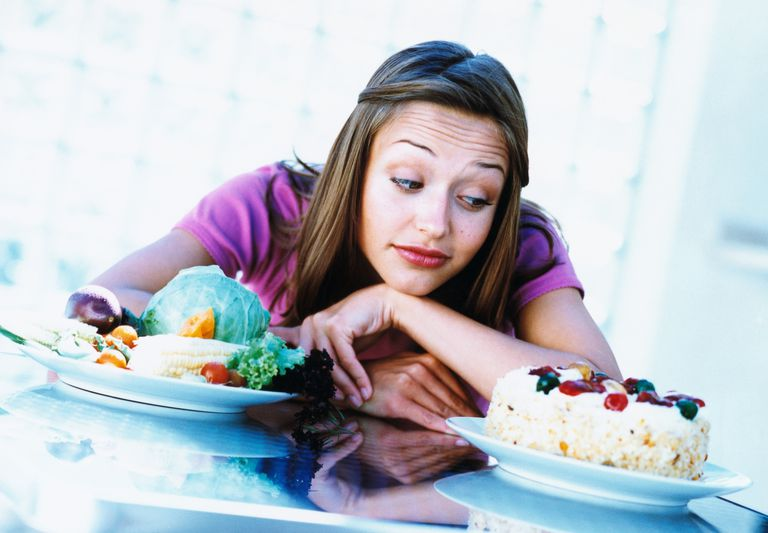 Woman tempted by cake