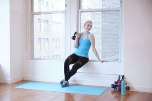 Woman holding kettle bell in exercise studio