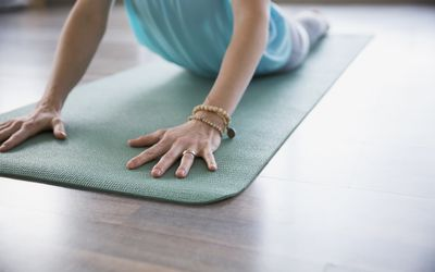 Woman practicing yoga in cobra pose