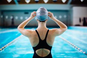 Woman in swim cap at pool
