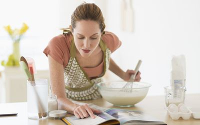 Woman looking at gluten free cookbook