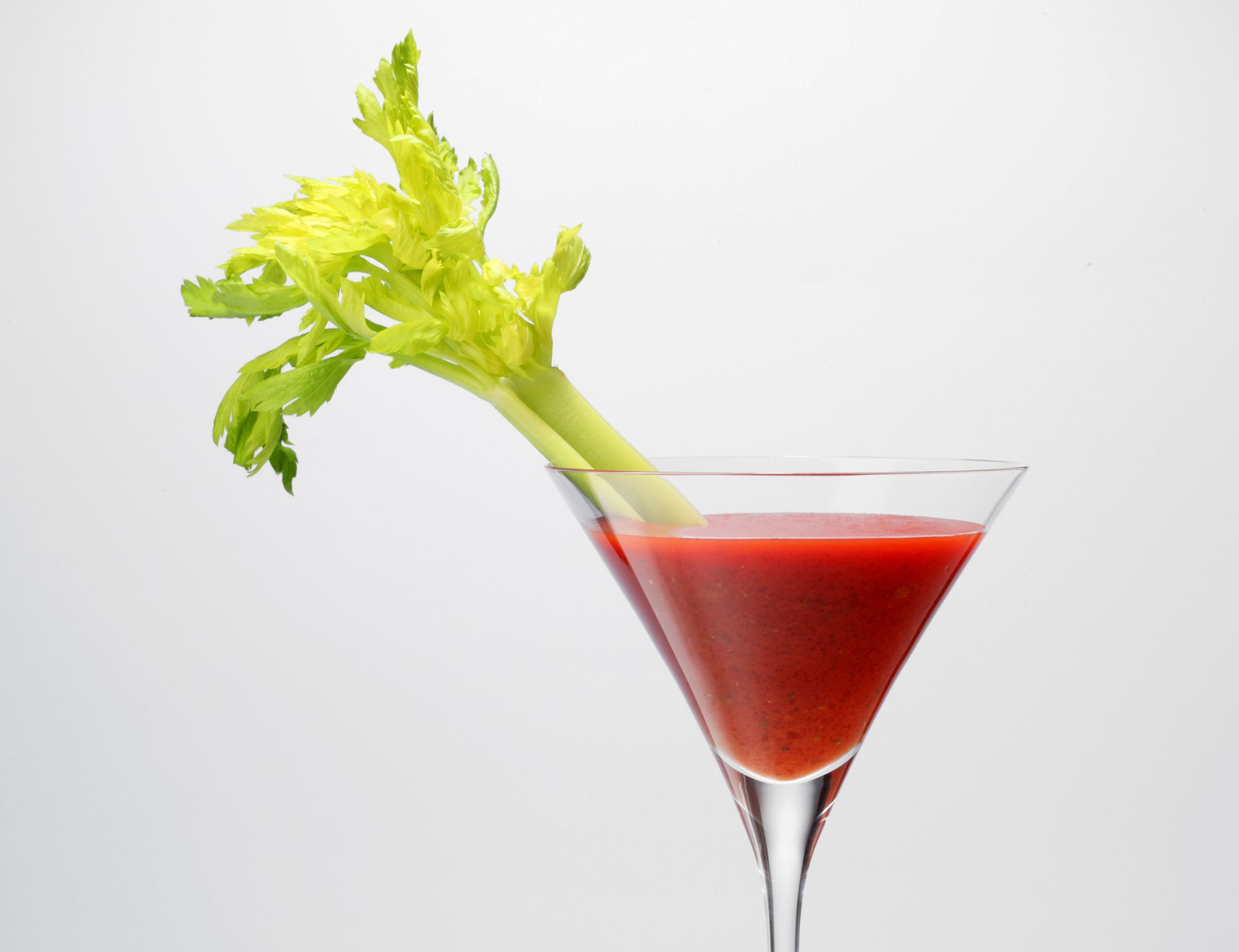 Tomato juice in a glass with a celery stick
