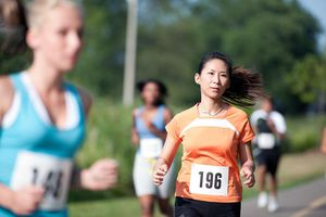 A young woman at a cross country running race.