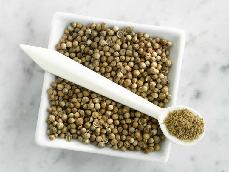 Coriander seeds and coriander powder, close-up