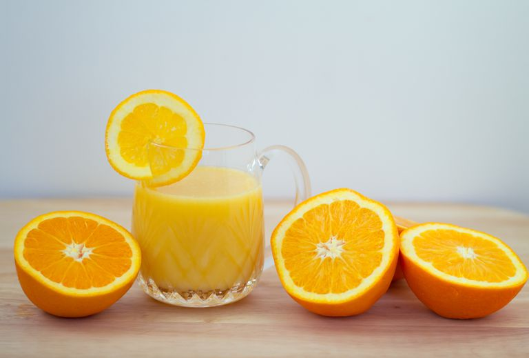 Sliced oranges and a glass of oj