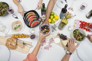 overhead shot of group of people sharing healthy meal outside