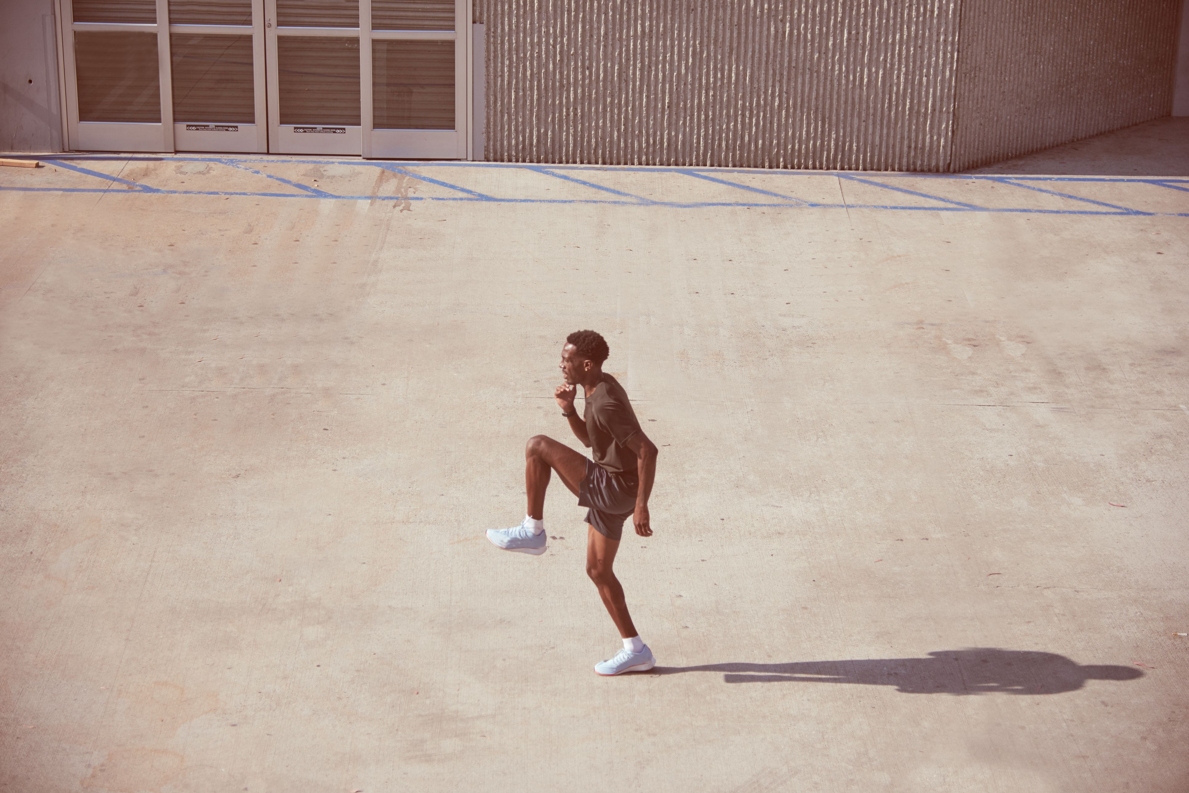 Athlete exercises in parking lot