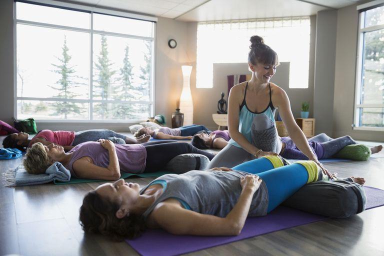 Yoga Teacher Helping Students Set Up for Yoga Niidra