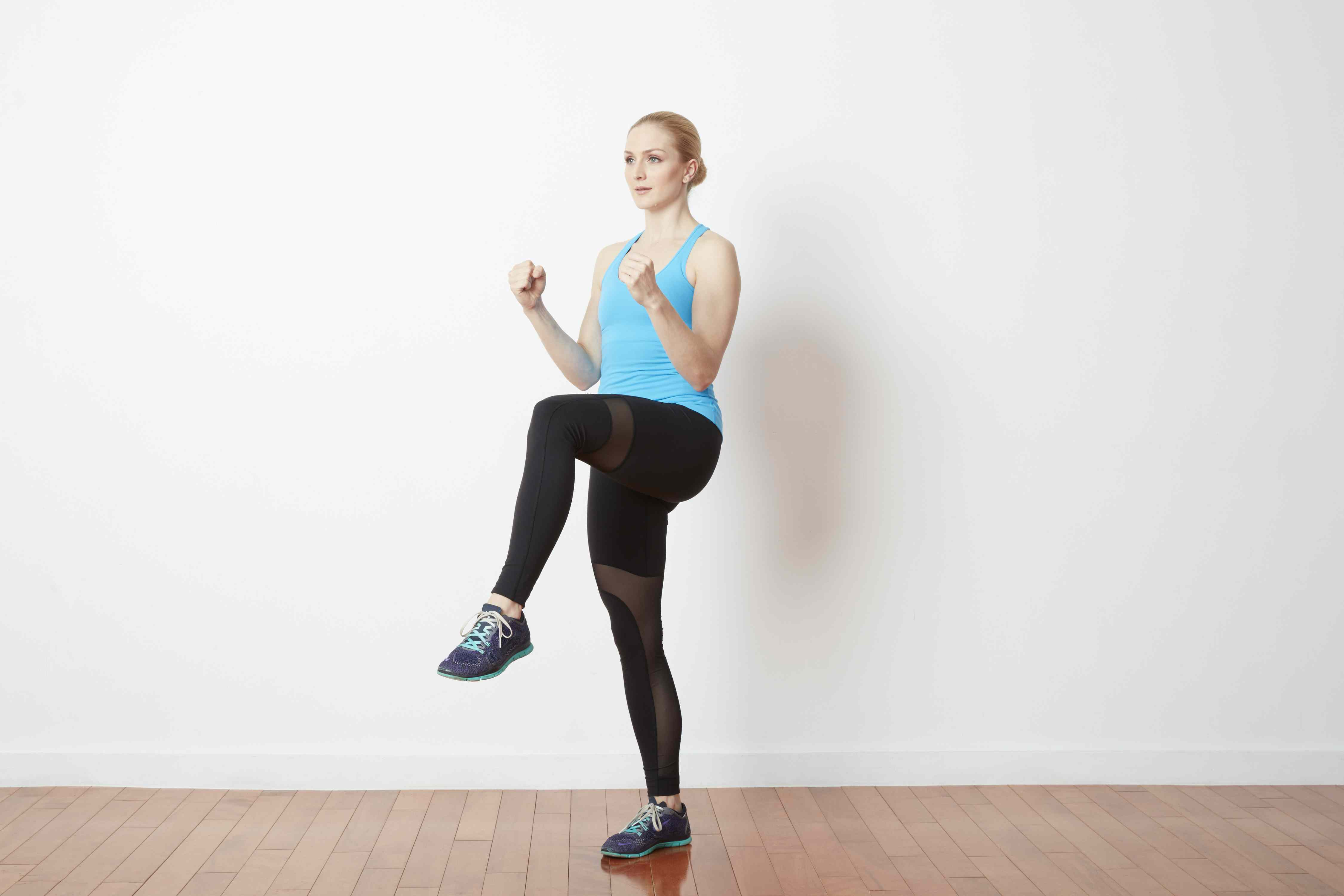 Woman jogging with high knees