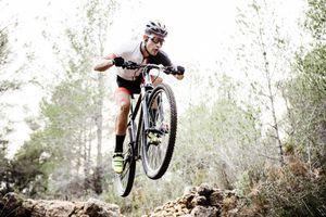 Mountainbiker jumping midair