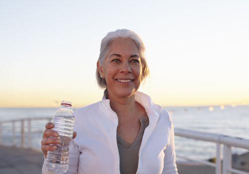 Woman with Water Bottle Walking
