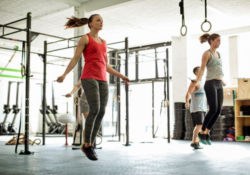 Women jumping rope in a gym